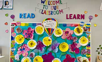 Bulletin Board with Art Flowers Created By Children