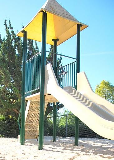 Large slide in sandy base.
