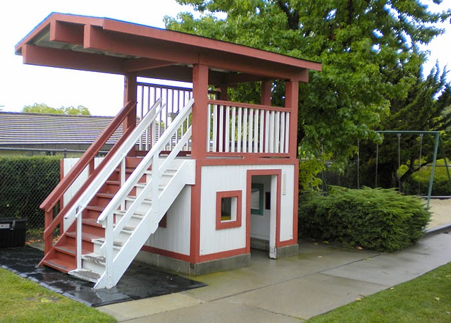 Large, 2-store playhouse in our play yard.