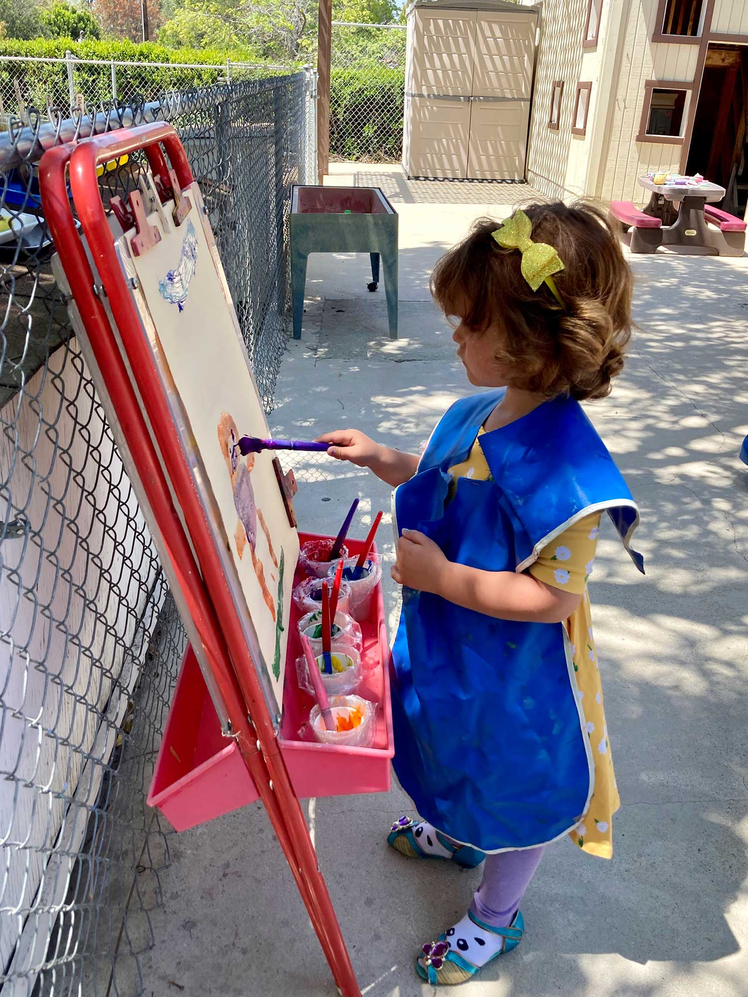 Girl Painting at an Easel