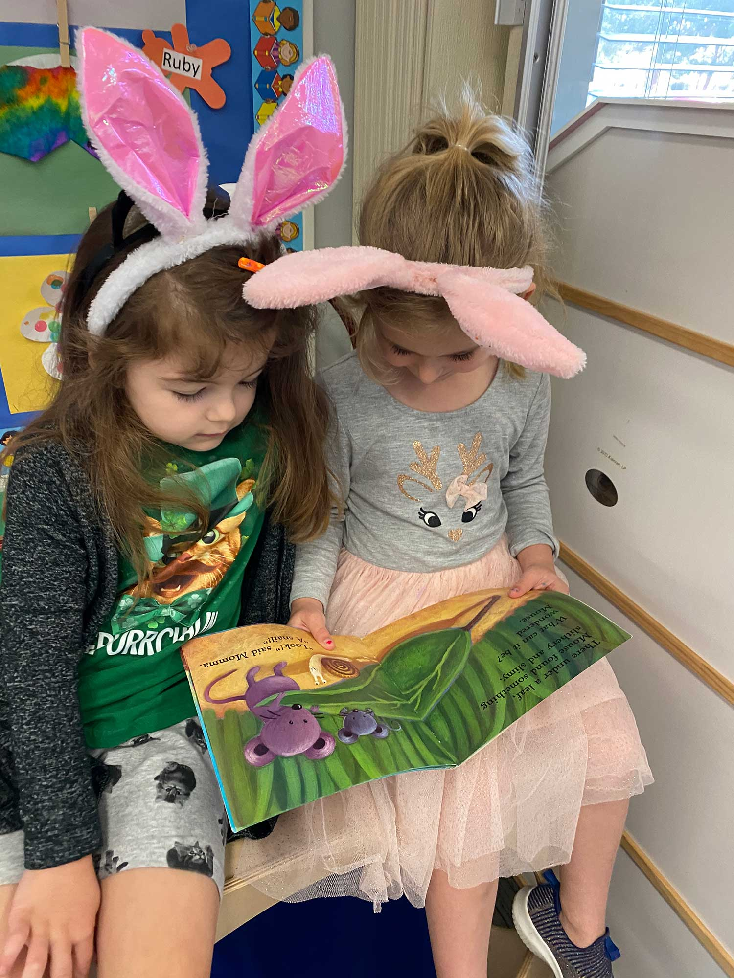 Two Girls Reading With Rabbit Ears