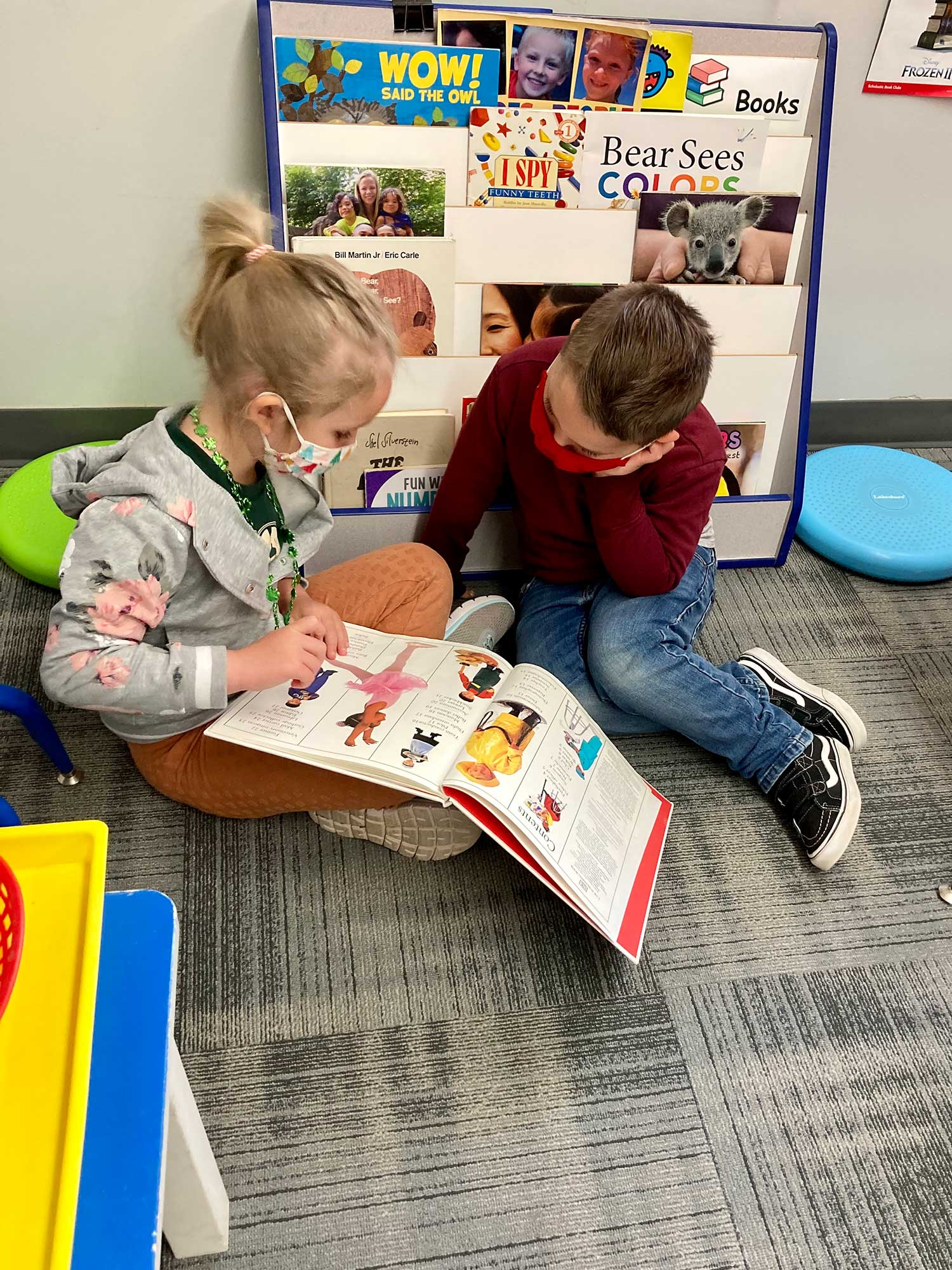 Boy and Girl Looking at a Book