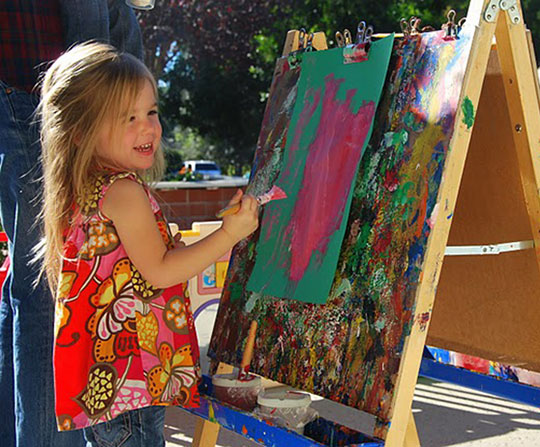 Child Painting at an Easel